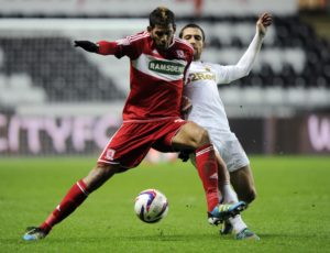 Swansea City's Schechter challenges Middlesbrough's Haroun during their English League Cup soccer match in Swansea